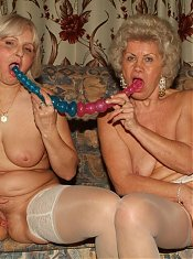 Older babes Steph And Julianna flaunt their wrinkled asses while toy fucking their muffs