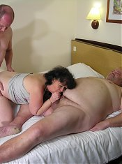 Horny mature slut takes on two cocks at once