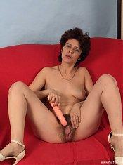 Horny mature slut masturbating and sucking cock
