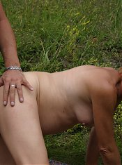 This red mature slut gets done in the grass
